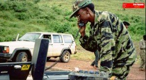 Gen.-Kagame-on-satellite-phone-300x165